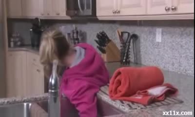 Mom gets stuck in sink
